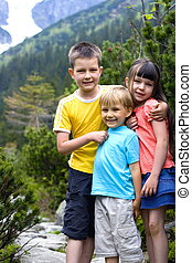 happy family - children in mountain