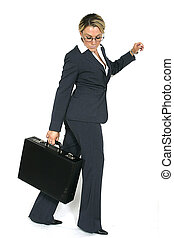 Business woman walking - a business woman, against white