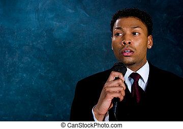 Businessman - Speech time - An African American man in a...
