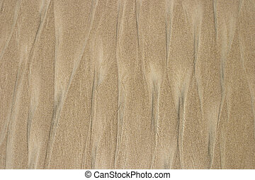 Beach Sand Background - Beach sand after a passing wave and...
