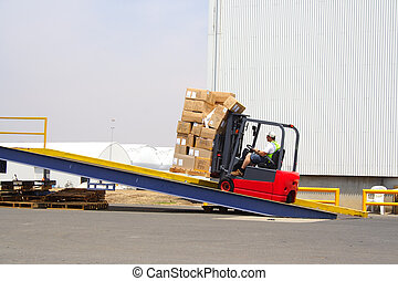 Fork Dock - forklift driver on a loading ramp with boxes