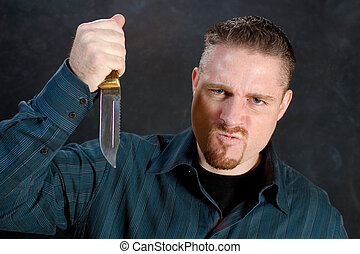 Murderous rage - Man with a knife in a murderous rage