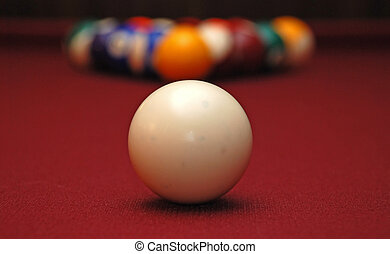 cue ball - a cue ball, with the racked balls in the...