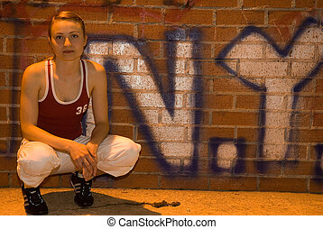 street girl - young pretty girl in sport clothes in front of...