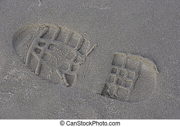 footstep in the sand on the beach