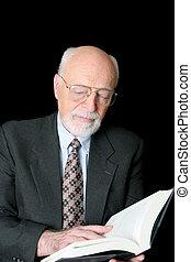 Senior Scholar - An educated senior man reading a book...