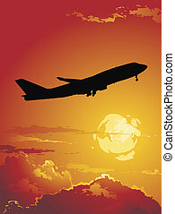 Flight - silhouette of a plane flying over the sunset
