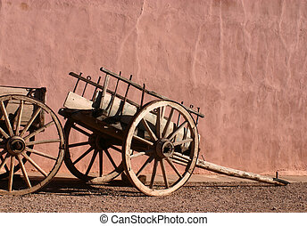 Antique Wagons and Adobe Wall - Antique wagons in front of...