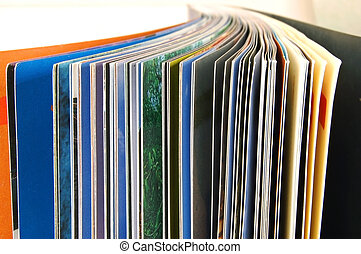 Booklet - Slightly spread pages of a color booklet