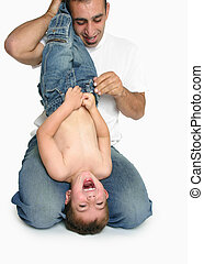 Fun and laughter with Dad - A child laughs gregariously...
