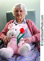 Senior citizen - 94 year old Senior citizen holding easter...
