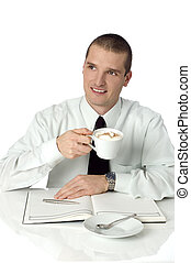 businessmen drinking coffee behind the table close up