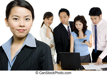 Businesswoman and Team - A young asian businesswoman...