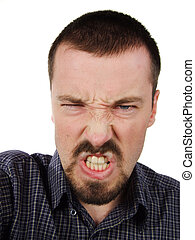 Excessively angry facial expression - Young adult male....