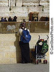 westren wall - woman in the westren wall in jerusalem