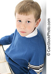 Boy Reading - Adorable 8 year old boy leaning against wall...