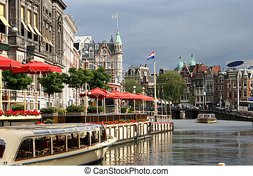 Amsterdam - Tour boats in a canal outside a restaurant in...
