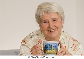 tea - elderly woman in pyjama drinking tea