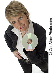 business woman - young business woman holding compact disc...