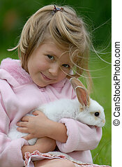 girl with a rabbit - little girl with a rabbit
