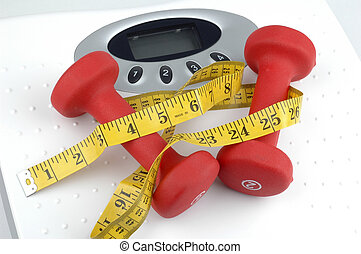 Weights and Scale - Weights on top of a weight scale.