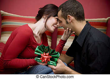 valentine\\\'s day - man and woman smiling and holding each...
