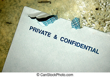 Private and confiden - An opened white envelop which is...