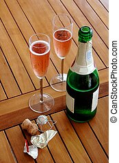 Champagne breakfast - A bottle of red sparkling wine and two...