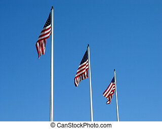 Three American Flags - Three American flags on poles at a...