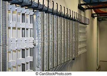 cross connect field - 66 blocks mounted on wall in telecom...