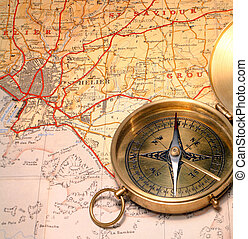 Map and compass - Ordinary magnetic compass on a 1930s map...