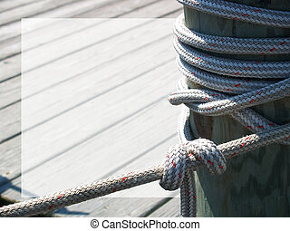 Dock Mooring - Thick rope tied around a dock piling