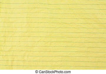 crumpled yellow lined paper close up