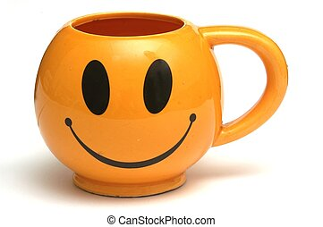 Smiley cup - One orange cup with a smiling face.