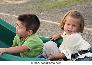 Go Away! - Annoyed little girl trying to push her brother...