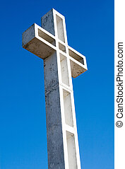 Religious cross against sky background