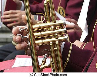 brass cornet - closeup of man\\\'s hand playing a trumpet