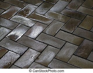 Wet pavement - Pavement with square tiled pattern after a...