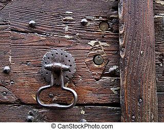 Wooden door, knocker and keyholes - Rusty iron door knocker...