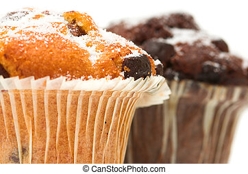 Chocolate Muffins - Chocolate chip muffins against a white...