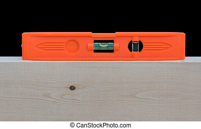Level - A red level on top of a wood 2X4 stud The level...