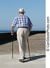 Disabled Gentleman - Rear view of an elderly man walking...