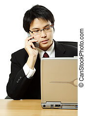 Busy businessman - A businessman making a phone call and...
