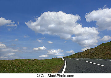 Escape to Nowhere - Steep uphill road with grass verges on...