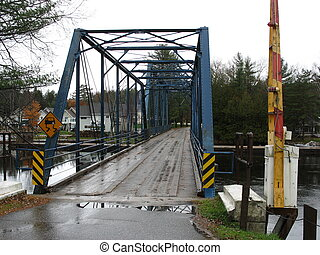 iron swing bridge - century old swing bridge up in the...