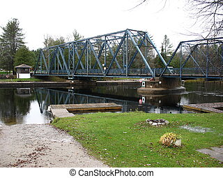 iron swing bridge - century old swing bridge over the...