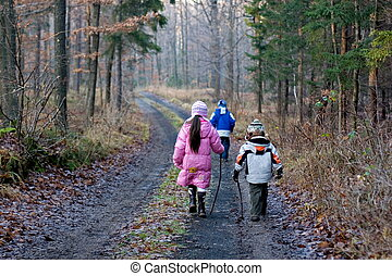children in forest - sister with brothers in forest