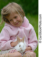 the little girl with a rabbit