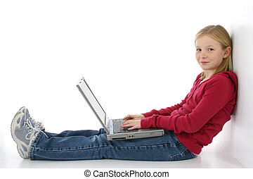 Tween on Laptop - Beautiful young girl working on laptop....