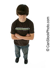 Tween Boy - Handsome twelve year old boy standing with arms...
